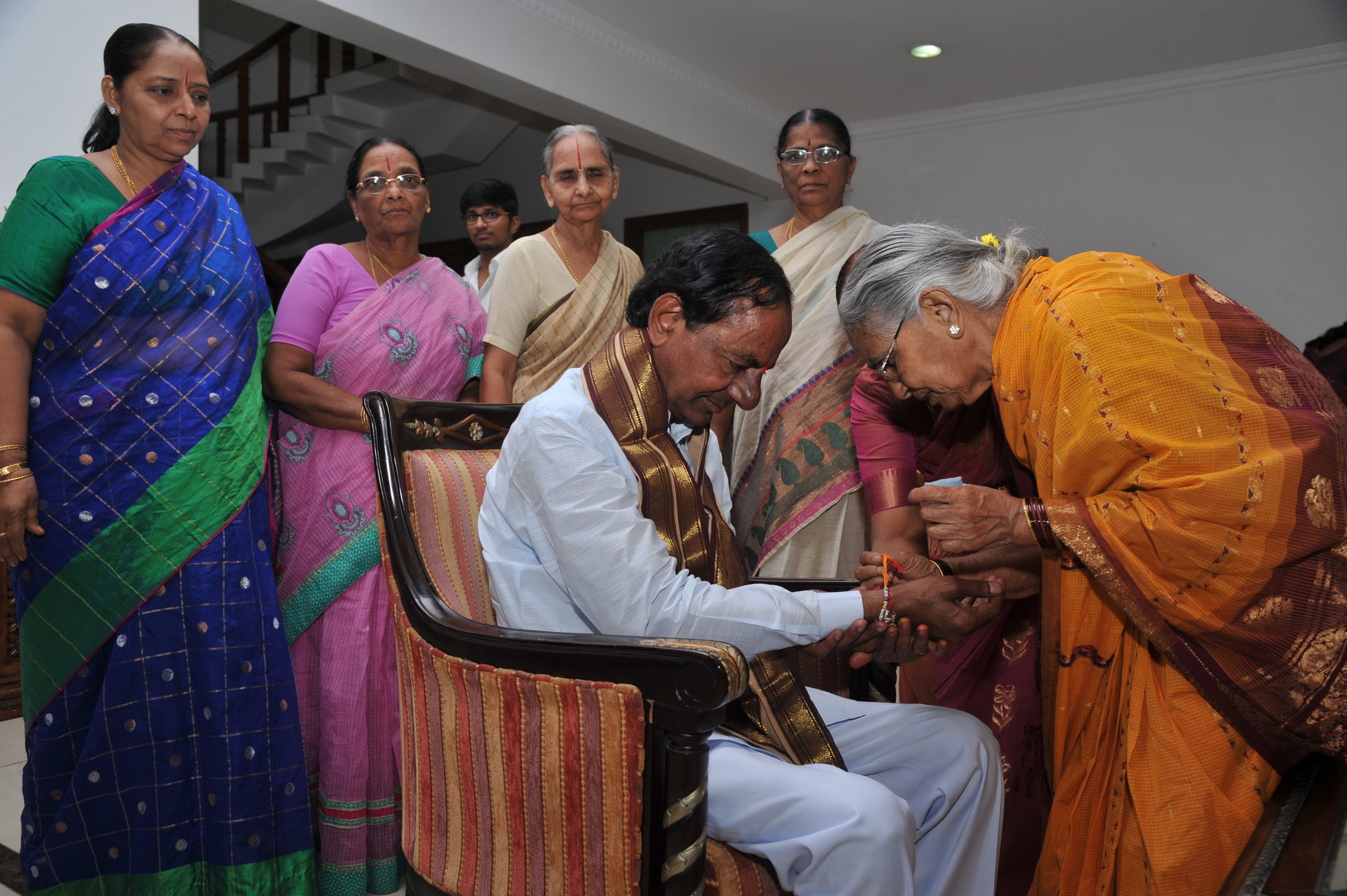 Telangana Chief Minister K.Chandrashekhar Rao tying Rakhi at CM Camp office Hyderabad on 29-08-2015.