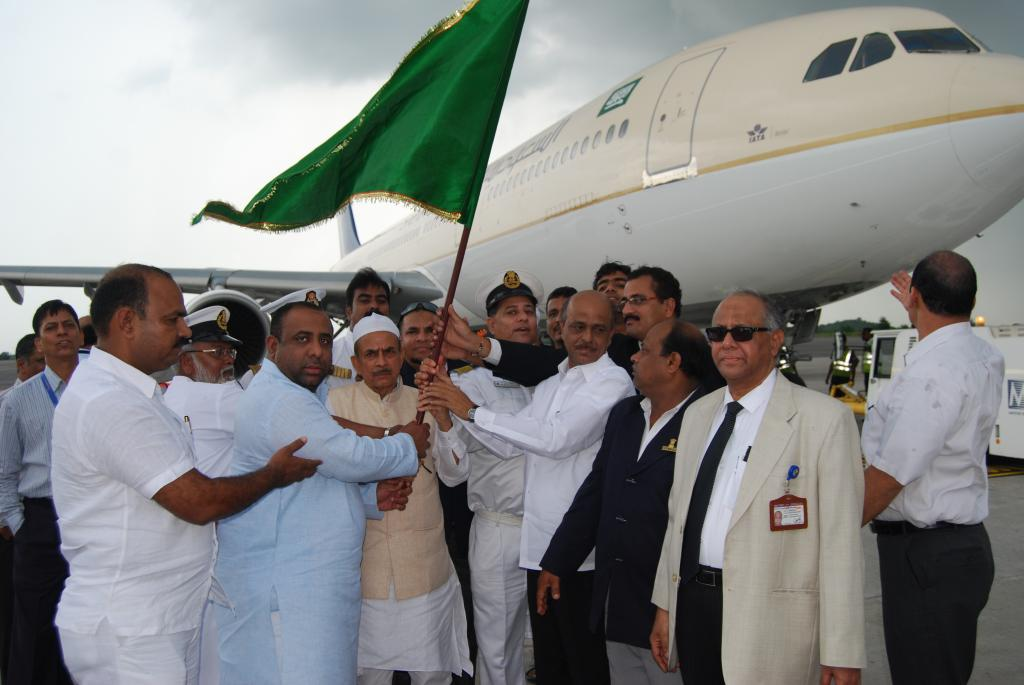 TS Dy.CM Mahmood Ali is seen flagging off the first batch of the Haj Pilgrims on 14.9.14 Gallery