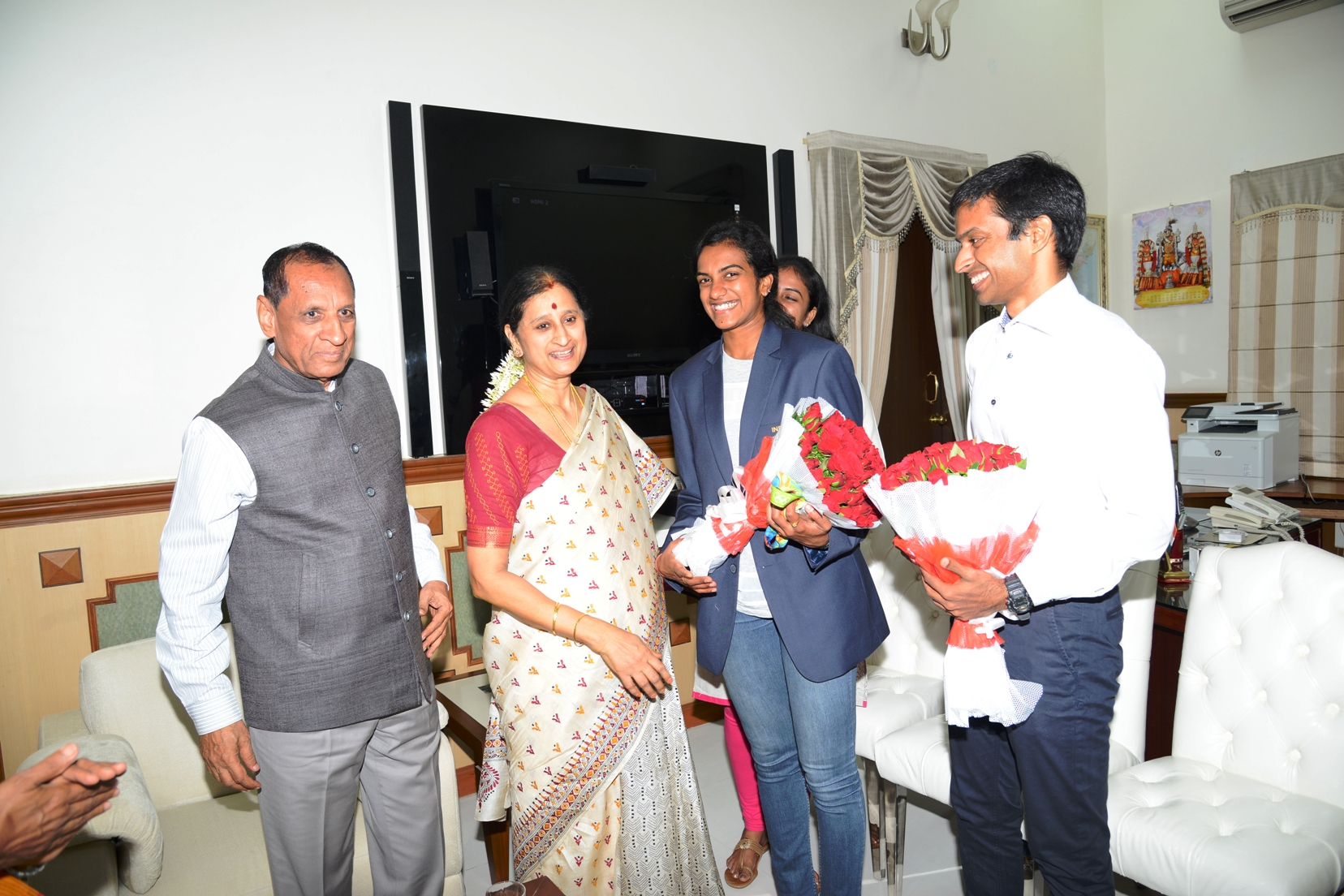 AP, TS Governor E.S.L. Narasimhan had invited PV Sindhu and her coach Pullela Gopichand to congratulate on her successes at rio Olympics on 22.08.2016