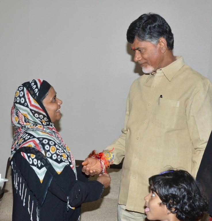 WOMEN AND CHILDREN TIEING RAKHI TO AP CM N.CHANDRABABU NAIDU AT HIS HOME ON 10-08-2014. GALLERY