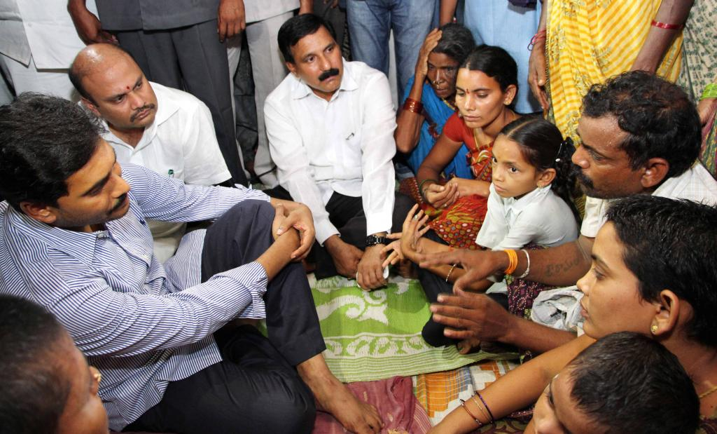 YS Jagan consoling family members of building collapse mishap in Chennai at Vizianagaram dist Galler