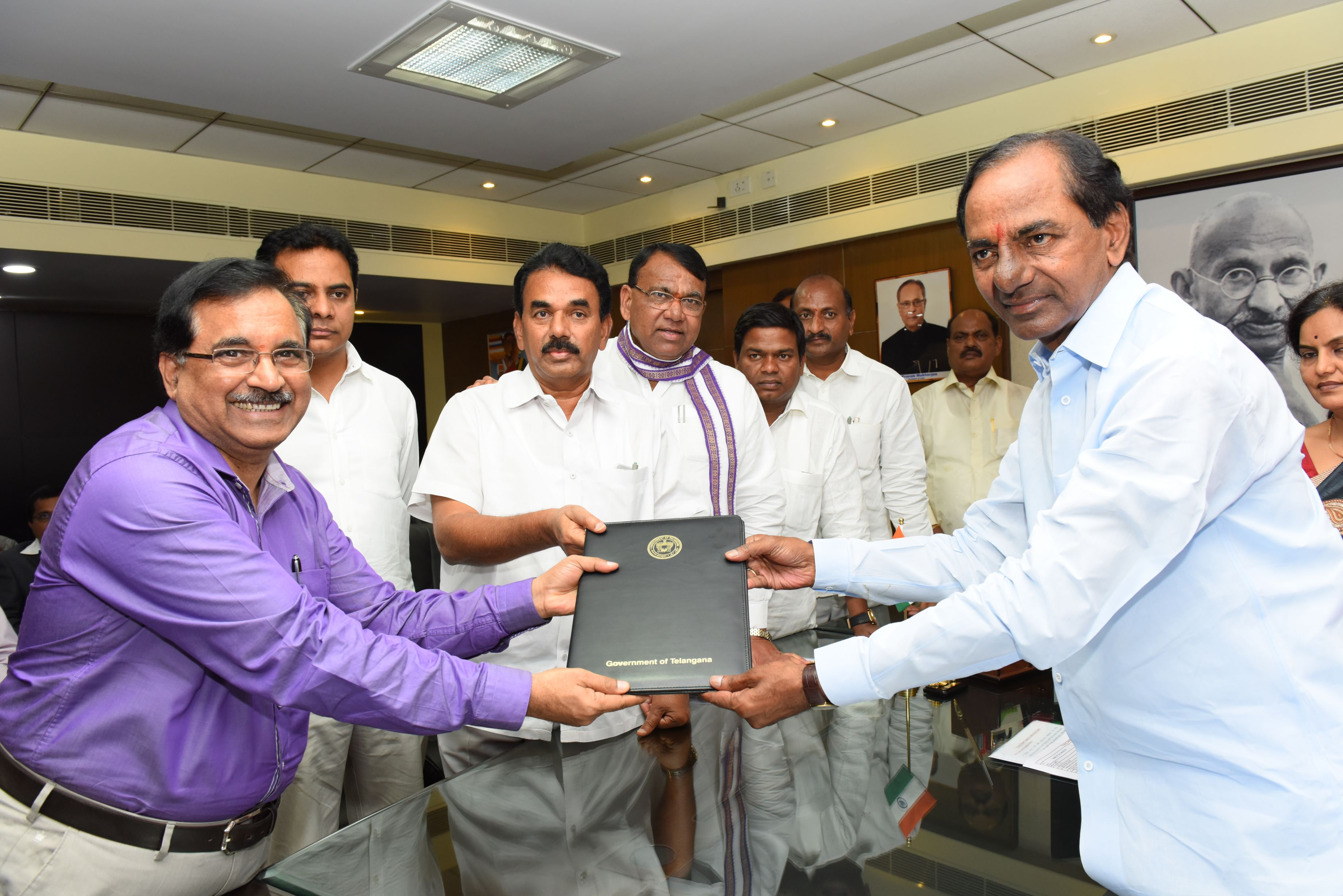 TS CM KCR Handing over package of permit papers to the Industrialists on 23-6-2015.