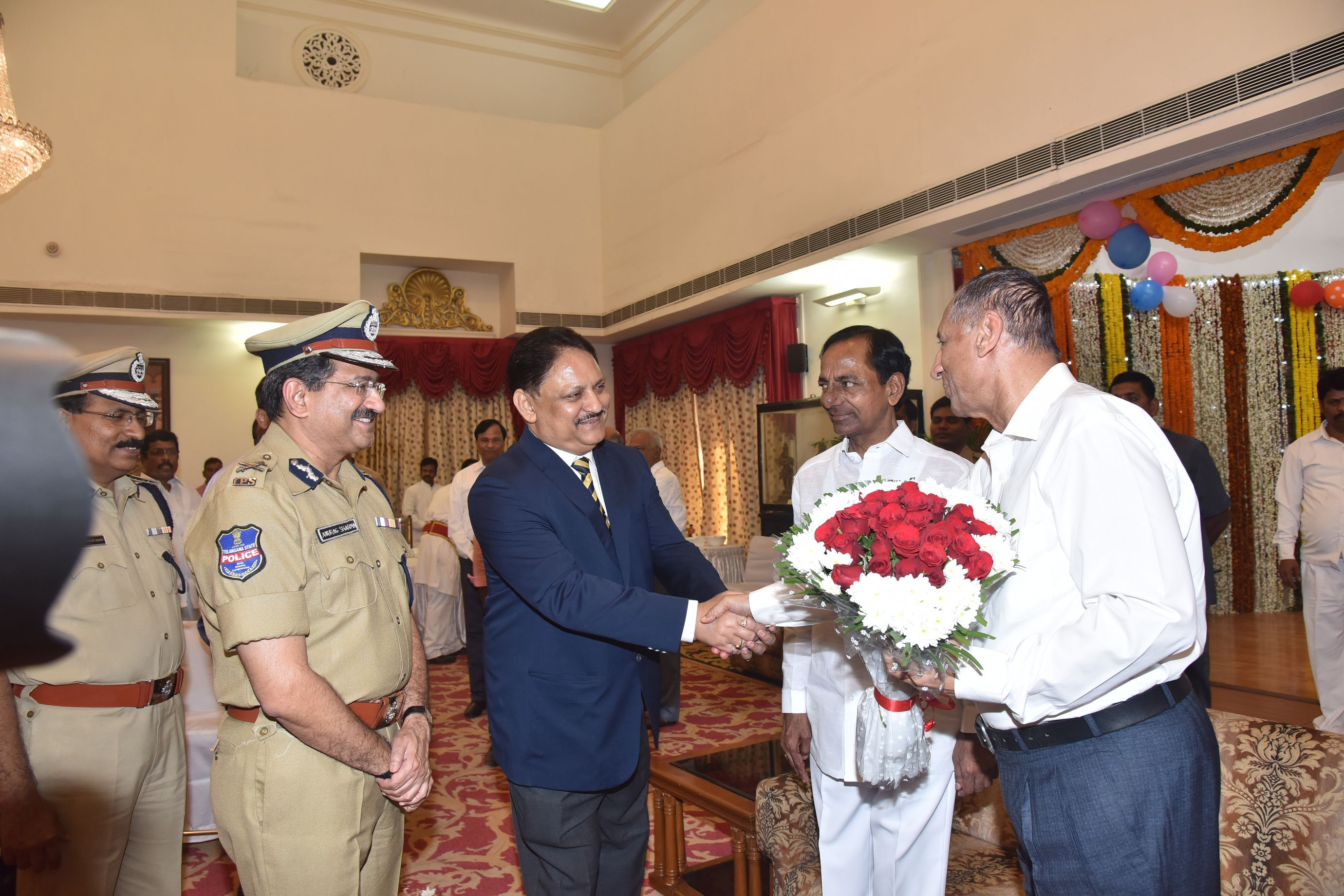 Telangana CM K Chandrasekhar Rao and Governor ESL.Narasimhan, other govt officeals, Leaders Participated in New Year Celebrations at Rajbhavan on 01-01-2017.