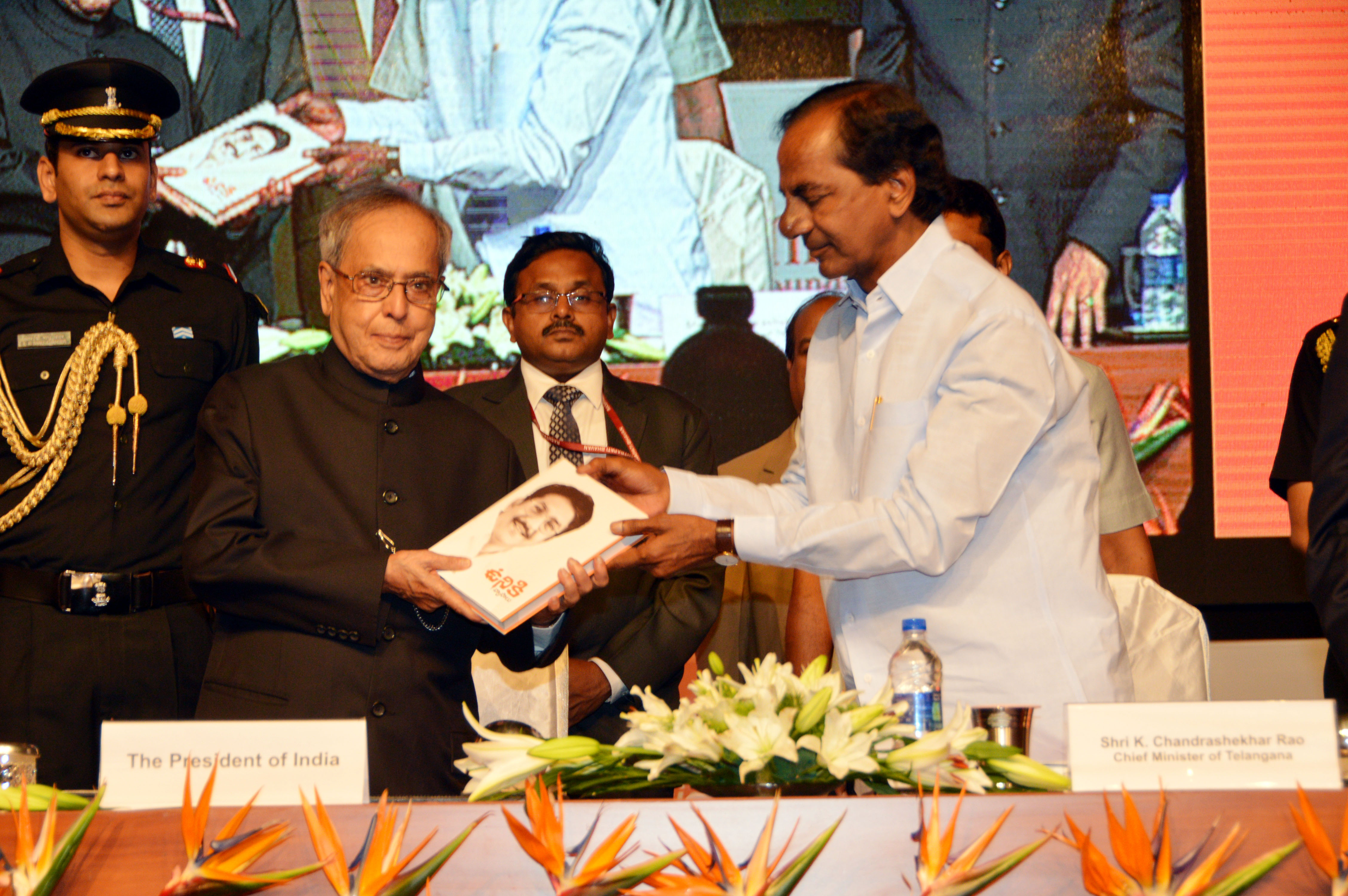 K.Chandrashekar Rao, Chief Minister of Telangana presenting the first copy of UNIKI authored by CH.Vidyasagar Rao, Hon ble Governor of Maharashtra to Pranab Mukherjee, Hon ble President of India at HICC on 03.07.2015.