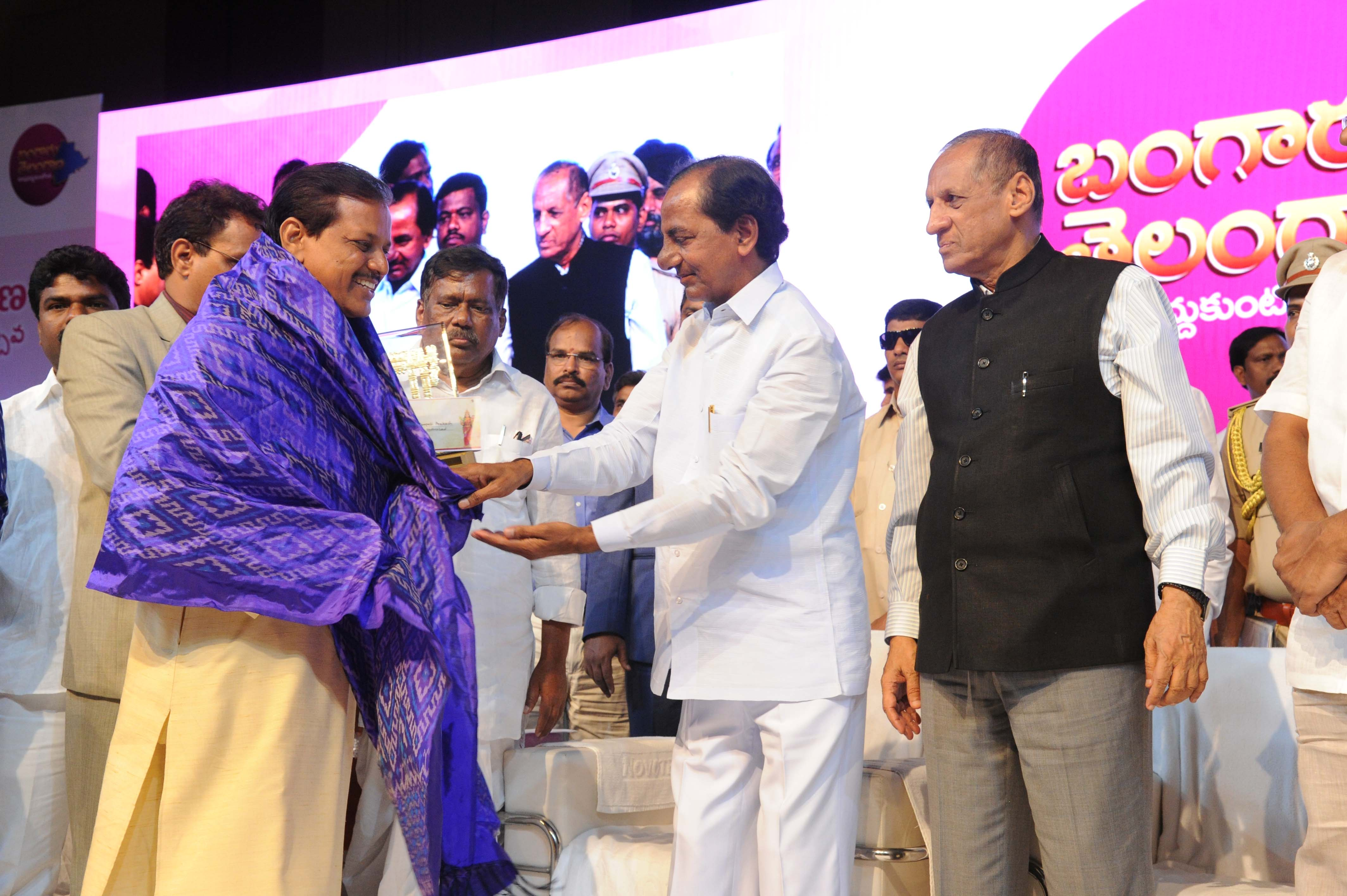 Governor ESL. Narasimhan and TS Chief Minister K. Chandrashekhar Rao at the Special meeting of Telangana State Formation Day Celebrations at HICC, Madhapur on 02-06-2016